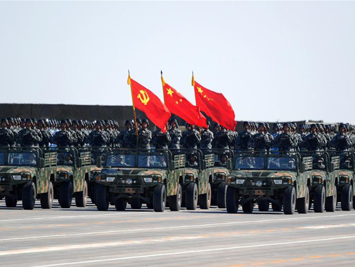 A flag guard formation consisting of officers and soldiers from the army  air force  navy and rocket force of the chinese people s liberation army  pla  attends a military parade to mark the 90th anniversary of the founding of th
