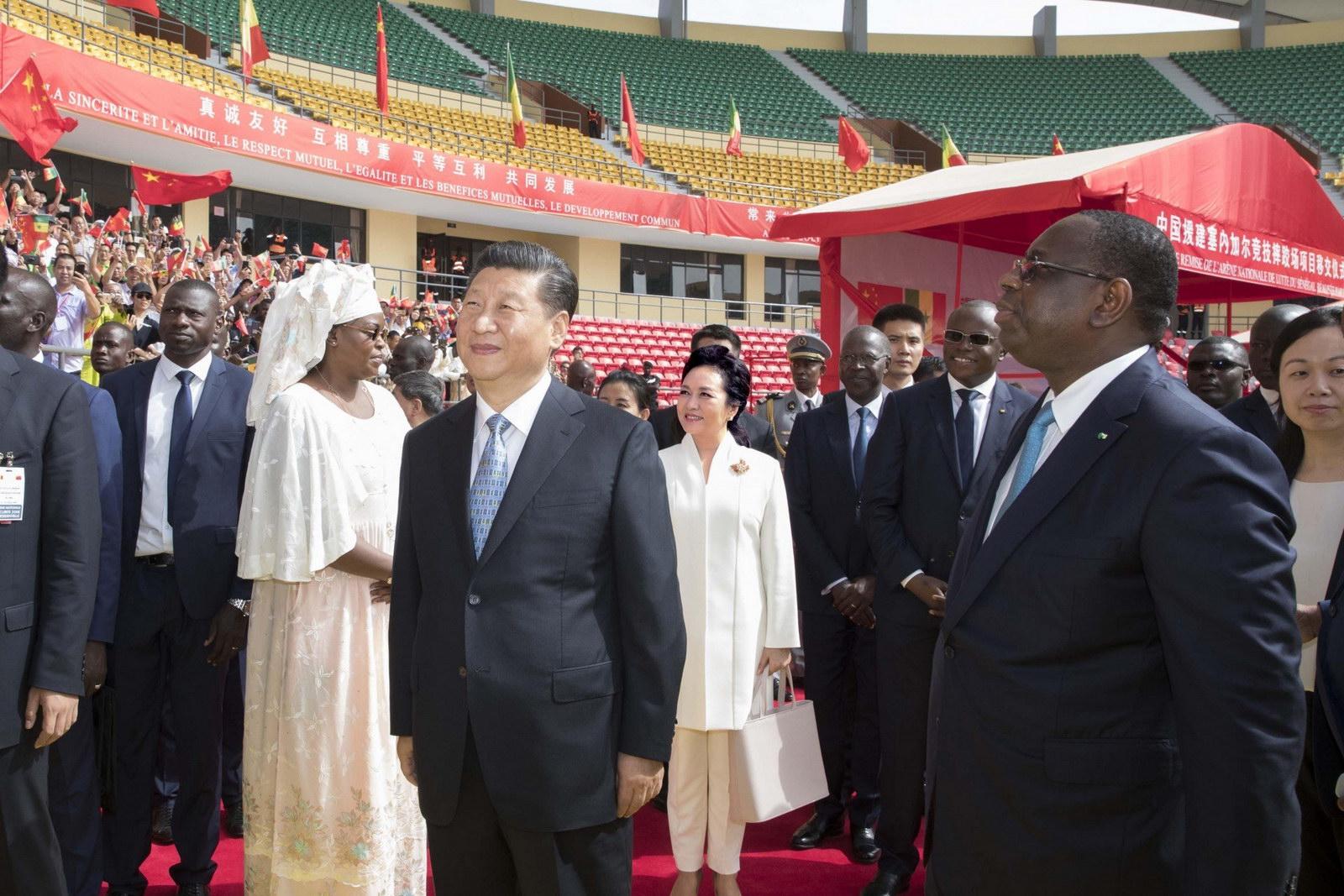 Xi attends handover ceremony of senegals national wrestling arena