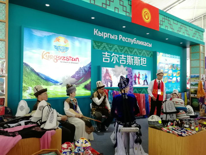 Exhibitors from Kyrgyzstan showcase their products and culture at a tourism product exhibition held in Jiayuguan, Gansu Province, on June 20 (WANG HAIRONG)