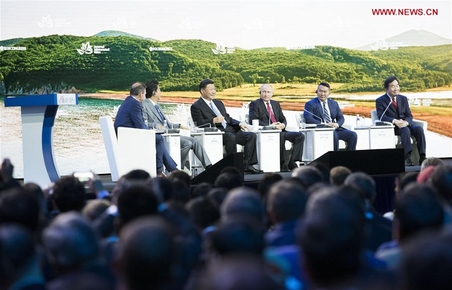Chinese President Xi Jinping (3rd L, rear) attends the plenary session of the fourth Eastern Economic Forum (EEF), together with Russian President Vladimir Putin, Mongolian President Khaltmaa Battulga, Japanese Prime Minister Shinzo Abe and South Korean Prime Minister Lee Nak-yon, in Vladivostok in Russia's Far East, on Sept. 12, 2018. (Xinhua/Huang Jingwen)
