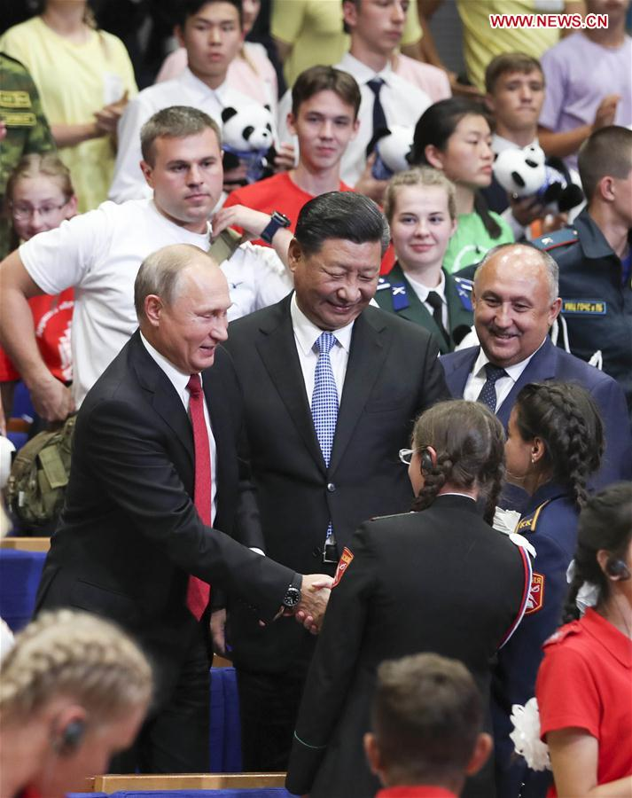 "Chinese President Xi Jinping and Russian President Vladimir Putin talk with children at the All-Russian Children's Center ""Ocean"" while attending commemoration events marking the 10-year anniversary of the center's hosting of hundreds of Chinese children from regions hit by a deadly earthquake in 2008, in Vladivostok, Russia, Sept. 12, 2018. (Xinhua/Xie Huanchi)"