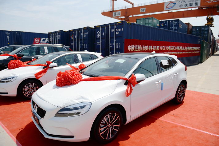 Imported Volvo cars arrive at a railway station in Xi'an, northwest China's Shaanxi Province, on June 13 (XINHUA)