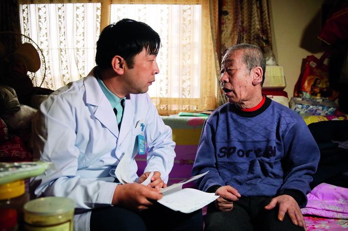 April 3, 2018: Zhao Sheng, a physician at Erqibei Community Healthcare Center in Fengtai District, Beijing, conducts a physical examination of a local resident.  VCG