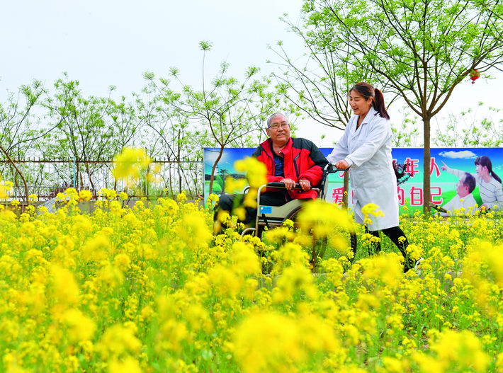 April 15, 2018: A senior in a wheelchair in Julu County, Hebei Province, is aided by a nurse. In recent years, China has placed more attention on addressing the needs of its booming elderly population.  by Mou Yu/Xinhua