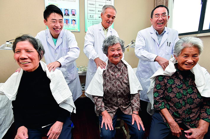 October 9, 2016: Health workers perform physical therapy on seniors in Yangzhou City, Jiangsu Province. By the end of 2017, China was home to 241 million seniors aged 60 and above, accounting for more than 17 percent of its total population. VCG