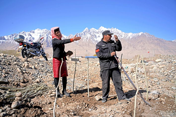 Locals plant sea buckthorn in Xindie Village. The village had officially been lifted out of poverty by 2017. But locals were not content and still desired to expand their road to prosperity.