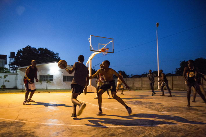Some medical workers play basketball at the living area of the China-Zambia Friendship Hospital.