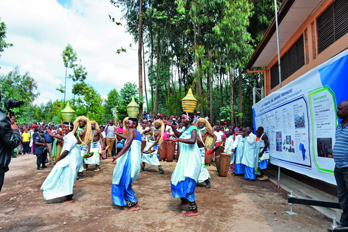 June 28, 2018: Locals perform a dance at the launch ceremony of a digital satellite TV project from China to aid Africa in Musanze, northern Rwanda. This project, mainly implemented by StarTimes, has provided digital television signal to 10,112 villages in 25 African countries since it kicked off in August 2017.  courtesy of StarTimes Group