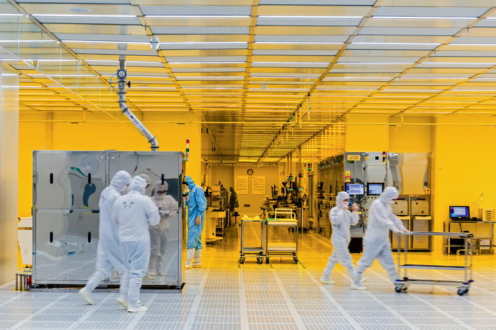 A group of workers from SJsemi, a semiconductor foundry in Jiangyin, check facilities in a wet processing zone.  by Gu Qiang