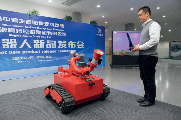 December 5, 2017: An engineer displays an intelligent robot for special firefighting, co-produced by Siemens and China's Qingdao Aucma Group.  VCG
