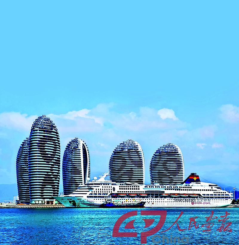 Vcg111140866284  2014年7月17日 海南凤凰岛位于三亚湾的东南端 是一座在大海礁上填出的人工岛 岛上的五栋酒店建筑恢宏前卫 是海面上最亮丽的风景线