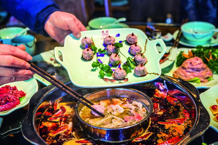 Today, Chongqing Qiaotou Hotpot with its robust hot and spicy flavors is booming across China.  by Ma Gengping