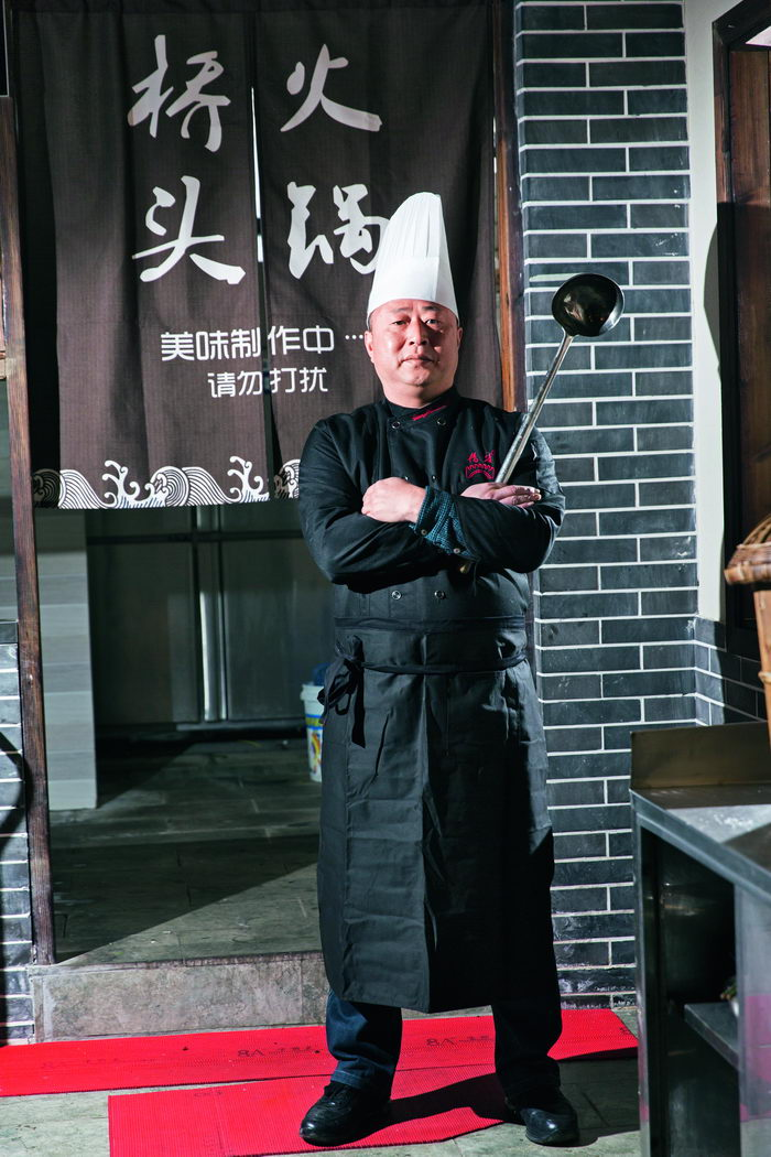 Li Bo, the fourth-generation inheritor of the seasoning skills that have defined Chongqing Qiaotou Hotpot.  by Qin Bin